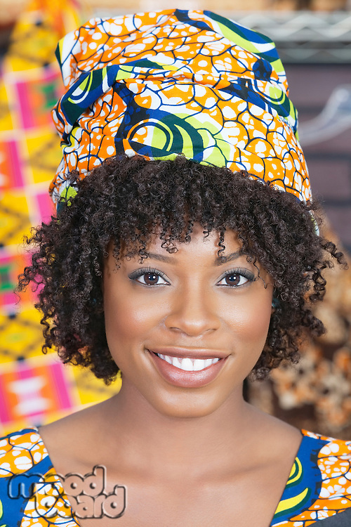 Close-up portrait of an African American woman wearing traditional head wrap