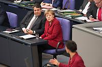 19 MAR 2015, BERLIN/GERMANY:<br /> Sigmar Gabriel (L), SPD, Bundeswirtschaftsminister, und Angela Merkel (M), CDU, Bundeskanzlerin, waehrend der von Sahra Wagenknecht (R), Die Linke, Stellv. Fraktionsvorsitzende, Bundestagsdebatte nach der Abgabe einer Regierungserklaerung durch die Bundeskanzlerin<br /> zum Europaeischen Rat, Plenum, Deutscher Bundestag<br /> IMAGE: 20150319-01-027