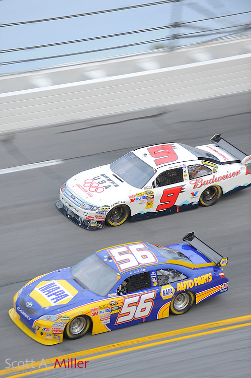 Feb. 11, 2010; Daytona Beach, FL, USA; NASCAR Sprint Cup Series drivers Martin Truex Jr. (56) and Kasey Kahne (9) in turn 4 during race two of the Gatorade Duel at Daytona International Speedway. ©2010 Scott A. Miller