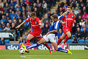 Chesterfield FC defender Ian Evatt and Gillingham FC midfielder Jake Hessenthaler challenge for the ball during the Sky Bet League 1 match between Chesterfield and Gillingham at the Proact stadium, Chesterfield, England on 10 October 2015. Photo by Aaron Lupton.