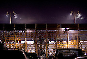 The back view of the bleachers at night at Johnson County Sheriffs Posse arena in Cleburne, Texas.