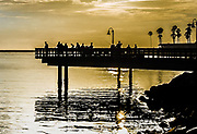 People Fishing Off The Oceanside Harbor Fishing Pier