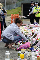 © Licensed to London News Pictures. 15/08/2012. Natalie Sharp, mother of Tia Sharp, crying at a memorial for the 12 year old on The Lindens, New Addington on August 15, 2012. Tia's mother Natalie Sharp and Tia's Step Father David Niles visit the memorial for half an hour as Tia's Step Grandfather, Stuart Hazell appeared at the Old Bailey by video link charged with murder. Photo credit : Grant Falvey/LNP