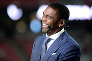 GLENDALE, AZ - SEPTEMBER 25:  ESPN analysts Randy Moss smiles on set during the MNF broadcast prior to the NFL game between the Dallas Cowboys and Arizona Cardinals at University of Phoenix Stadium on September 25, 2017 in Glendale, Arizona.  (Photo by Jennifer Stewart/Getty Images)