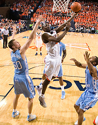 Virginia guard/forward Mamadi Diane (24) shoots past North Carolina forward Tyler Hansbrough (50). The the #5 ranked North Carolina Tar Heels defeated the Virginia Cavaliers 83-61 in NCAA Basketball at the John Paul Jones Arena on the Grounds of the University of Virginia in Charlottesville, VA on January 15, 2009.