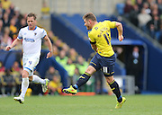Oxford United midfielder Alex MacDonald (11) shoots during the Sky Bet League 2 match between Oxford United and AFC Wimbledon at the Kassam Stadium, Oxford, England on 10 October 2015.