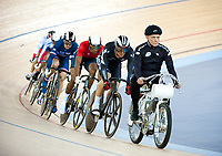 London, England, 12-02-18. Competitors follow the motorcycle pace bike in the second round of the men's Keirin at the UCI World Cup, Track Cycling, Olympic Velodrome, London. Part of the London Prepares Olympic preparations.
