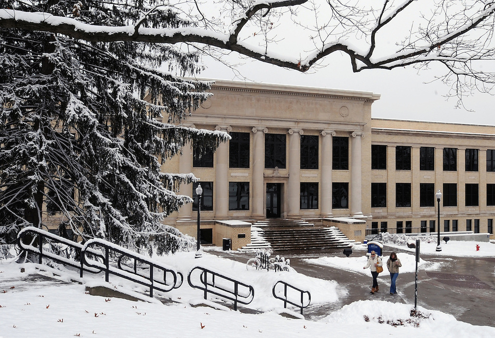 Students walk from class in front of Franklin Hall, the home of Kent State Journalism programs. Franklin Hall was rebuilt for the School of Journalism.