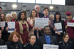 © Licensed to London News Pictures . 09/02/2015 . Manchester , UK . LIBBY LANE (back row , third from right) , the Bishop of Stockport , carries out her first public engagement since being ordained as the first woman Bishop in the Church of England . Bishop Libby Lane meets victims of human trafficking at Manchester Airport's Terminal 2 Arrival Lounge and speaks in support of efforts to clamp down on human trafficking . Photo credit : Joel Goodman/LNP