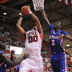 Jan 31, 2009; Piscataway, NJ, USA; Rutgers forward Gregory Echenique (00) puts up a shot under the reach of DePaul forward Devin Hill (3) during the second half of Rutgers' 75-56 victory over DePaul in NCAA college basketball at the Louis Brown Athletic Center