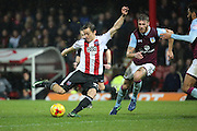 Brentford striker Lasse Vibe (21) shoots at goal during the EFL Sky Bet Championship match between Brentford and Aston Villa at Griffin Park, London, England on 31 January 2017. Photo by Matthew Redman.