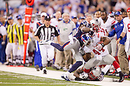 INDIANAPOLIS, IN - FEBRUARY 05:  Ahmad Bradshaw #44 of the New York Giants is hit by  Mark Anderson #95 and  James Ihedigbo #44 of the New England Patriots during Super Bowl XLVI at Lucas Oil Stadium on February 5, 2012. (Photo by Tom Hauck)