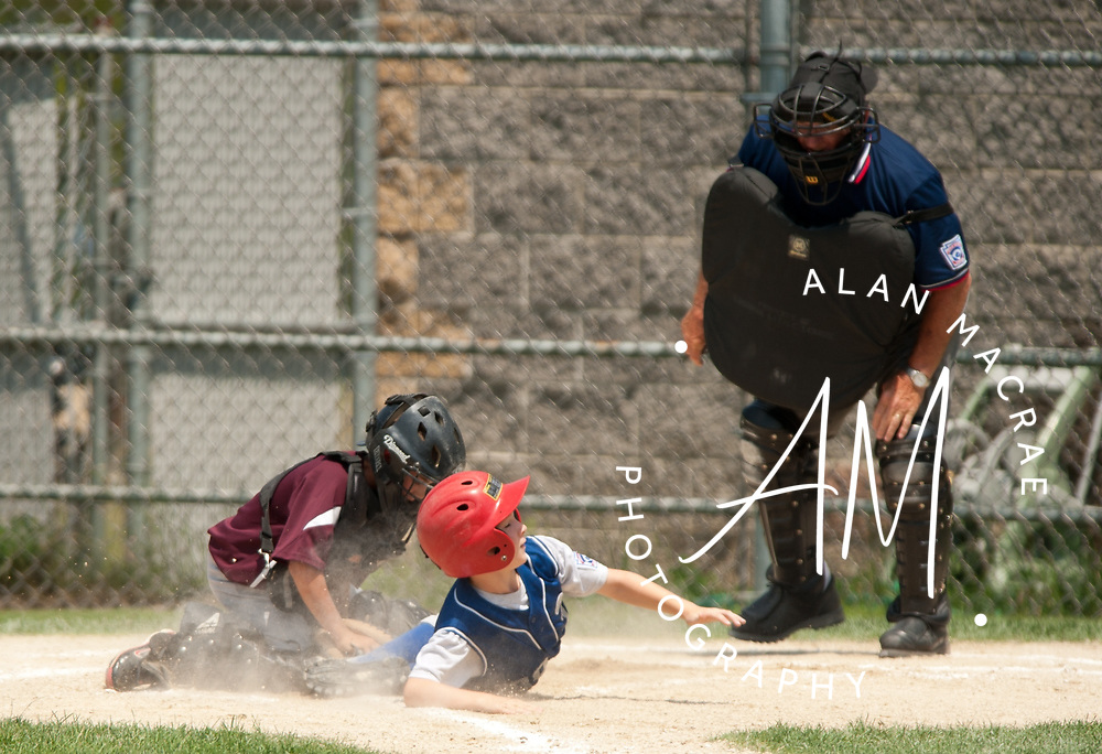 Portsmouth catcher Max Moore goes for the tag on Rye's Dylan King in game one of the 9 & 10 year old all star championship at Laconia's Colby Field on Saturday, July 17, 2010.  (Alan MacRae/for the Citizen)