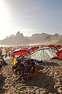 A crush of beach umbrellas seen during the holidays, or ferias, Ipanema Beach, Rio de Janiero, Brazil.