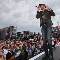 Country music superstar Luke Bryan performs before the 56th Annual NASCAR Daytona 500 practice session at Daytona International Speedway on Saturday, February 22, 2014 in Daytona Beach, Florida.  (AP Photo/Alex Menendez)