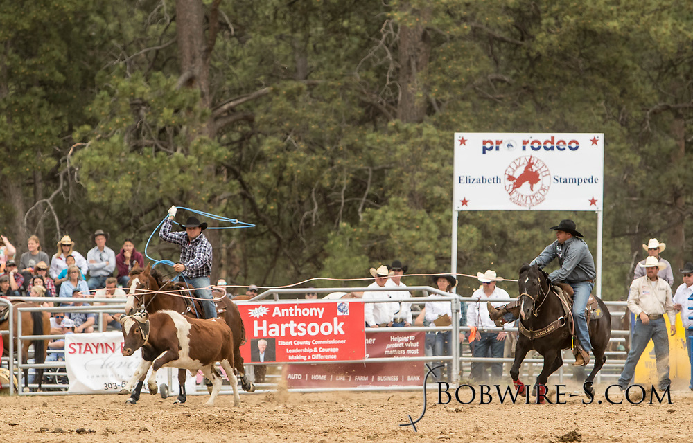 Header Ty Blasingame and heeler Levi Tyan make their team roping run during the third performance of the Elizabeth Stampede on Sunday, June 3, 2018.
