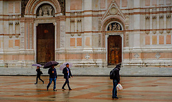 People walking in the rain in the early evening outside the Basilica di San Petronio, Bologna, Italy<br /> <br /> (c) Andrew Wilson | Edinburgh Elite media