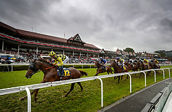 Smoki Smoka ridden by David Egan leads the field in the TMT Group Handicap during Boodles Ladies Day at Chester Racecourse.