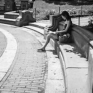 Young woman reading at Bethesda Terrace in New York City