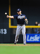 May 19 2011; Phoenix, AZ, USA; Atlanta Braves second basemen Dan Uggla (26) throws the ball to first base for the force out during the third inning against the Arizona Diamondbacks at Chase Field. Mandatory Credit: Jennifer Stewart-US PRESSWIRE..