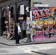 Orthodox Jew standing on street corner , East End, London