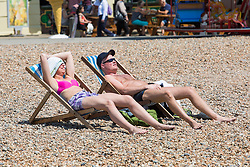 © Licensed to London News Pictures. 14/06/2017. Brighton, UK. Members of the public take advantage of one of the hottest days of the year to spend time sunbathing on the beach in Brighton and Hove. Photo credit: Hugo Michiels/LNP