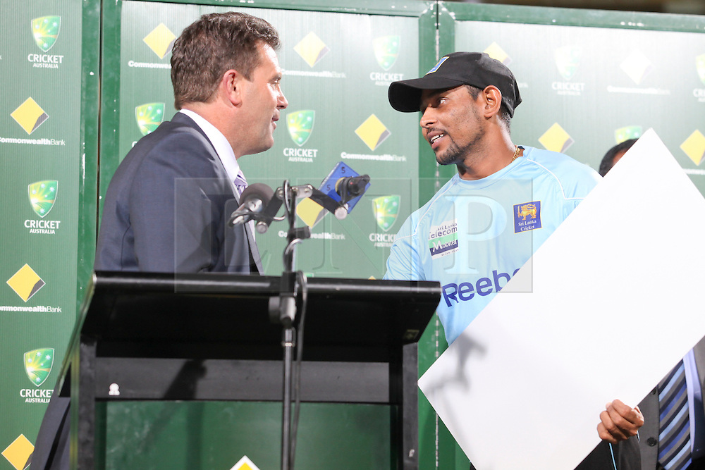 © Licensed to London News Pictures. 08/03/2012. Adelaide Oval, Australia. Sri Lankan Batsman Tillakaratne Dilshan (right) shakes hands with former Australian captain Mark Taylor after being awarded player of the series during the One Day International cricket match final between Australia Vs Sri Lanka. Photo credit : Asanka Brendon Ratnayake/LNP