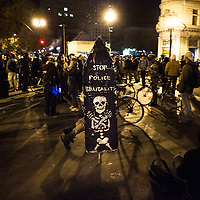 OAKLAND, CA - NOVEMBER 14, 2011: An Occupy Oakland protester hobbles by on crutches that he has fashioned into a sign of protest.