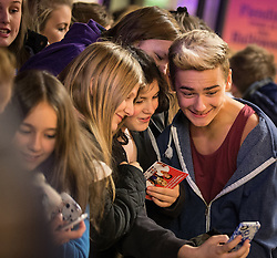 © Licensed to London News Pictures . 13/11/2013 . Merseyway Shopping Centre , Stockport , UK . RECONNECTED pose for selfies with fans . Stage acts perform ahead of the Merseyway Shopping Centre turning on their Christmas lights . Photo credit : Joel Goodman/LNP