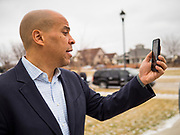 31 DECEMBER 2019 - ANKENY, IOWA: Sen US Senator CORY BOOKER (D-NJ) records a smart phone video before a house party in Ankeny, a suburb of Des Moines. Sen Booker is campaigning in Iowa over New Years to support his candidacy for the US Presidency. Iowa traditionally holds the first event of the presidential election cycle. The Iowa caucuses are Feb. 3, 2020.        PHOTO BY JACK KURTZ