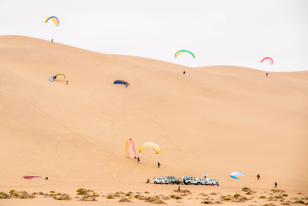 Parachuters landing from above In the Namib desert, located in Namibia, Africa.