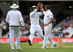 South Africa's Vernon Philander (right) celebrates England's Joe Root (not pictured) being caught out during day one of the 3rd Investec Test match at the Kia Oval, London.