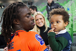 Mory Sidibe with his son and wife after the volleyball match between ACH Volley and Lube Banca Marche Macerata (ITA) in 5th Leg of Pool D of 2013 CEV Champions League on December 5, 2012 in Arena Stozice, Ljubljana, Slovenia. ACH defeated Macerata 3-1. (Photo By Vid Ponikvar / Sportida)