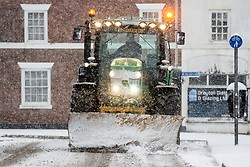 © Licensed to London News Pictures. 10/12/2017. Market Drayton UK. A snow plow clears the roads of snow this morning in the village of Market Drayton as Heavy snow begins falling in Shropshire. Photo credit: Andrew McCaren/LNP