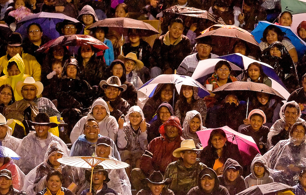 071208      Brian Leddy.Despite the rain, fans laugh as they watch a performance by the rodeo clown during the Wild Thing Championship Bullriding on Saturday evening. The annual event drew hundreds of spectators.