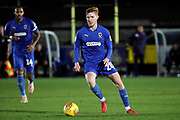 AFC Wimbledon midfielder Alfie Eagan (28) dribbling during the EFL Trophy group stage match between AFC Wimbledon and Stevenage at the Cherry Red Records Stadium, Kingston, England on 6 November 2018.
