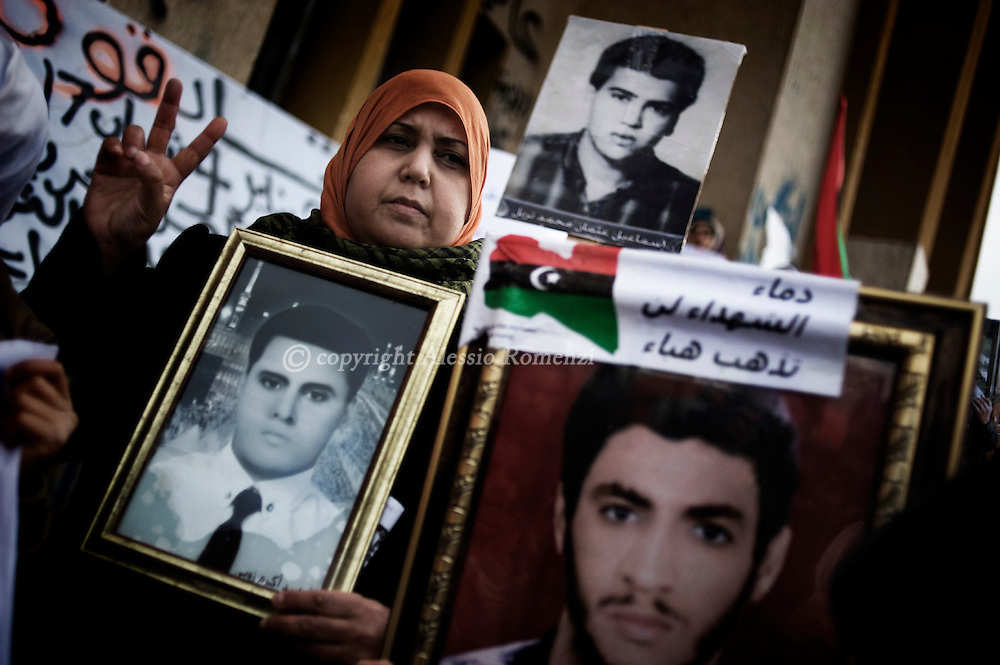 "LIBYA, BENGHAZI. Anti-Kadhafi demostrators show pictures of ""martirs"" murdered during the Kadhafi's regime on February 26, 2011. ALESSIO ROMENZI"