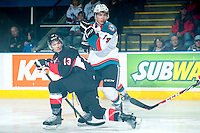 KELOWNA, CANADA - JANUARY 3: Rourke Chartier #14 of Kelowna Rockets checks Zach Pochiro #13 of Prince George Cougars on January 3, 2015 at Prospera Place in Kelowna, British Columbia, Canada.  (Photo by Marissa Baecker/Shoot the Breeze)  *** Local Caption *** Rourke Chartier; Zach Pochiro;