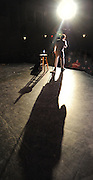 Photo by Phil Grout..Elvis Prestley imitator Joe Forrester casts a long shadow as he.sings his opening number for the fans at the Carroll County.Arts Council, especially for one fan in the front row, center seat.