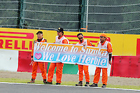 Marshals and fans of Herbie Blash (GBR) FIA Delegate.<br /> Japanese Grand Prix, Saturday 4th October 2014. Suzuka, Japan.