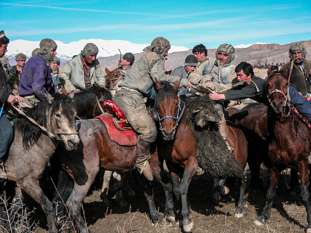 Image of Tajik horsemen fighting for control of the buz (a stuffed goat) in a melee at a buzkashi event in the village of Kostarosh, northwest Tajikistan