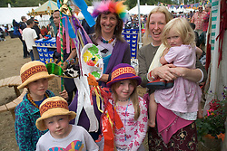 Group of women and children enjoying themselves at the WOMAD (World of Music; Arts and Dance) Festival in reading; 2005,