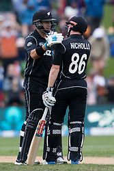 New Zealand's Ross Taylor, left, and Henry Nicholls celebrate their team's victory over England in the fourth one day cricket international at the University of Otago Oval, Dunedin, New Zealand, Wednesday, March 7, 2018. Credit:SNPA / Adam Binns ** NO ARCHIVING**