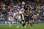 James Perch and Lewis Dunk compete for a cross during the EFL Sky Bet Championship match between Queens Park Rangers and Brighton and Hove Albion at the Loftus Road Stadium, London, England on 7 April 2017.