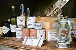 German rations consisting of tinned food chocolate along with looted wine and beer beside a hurricane lamp make up part of the 21st Panzer living history Dispaly at Croft Nostalgia Weekend 2010Images © Paul David Drabble..