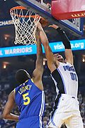 November 26, 2018; Oakland, CA, USA; Orlando Magic forward Aaron Gordon (00) shoots the basketball against Golden State Warriors forward Kevon Looney (5) during the first quarter at Oracle Arena.