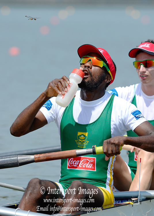 Chungju, South Korea.  RSA LM4-.  Lawrence NDLOVU, spots a flying insect  while waiting at the  start, Semi final A/B.  2013 Rowing Championships, Tangeum Lake, International Regatta Course.  Monday  26/08/2013 [Mandatory Credit. Peter Spurrier/Intersport Images]