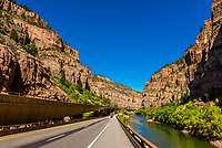 Interstate 70 passing through the 12.5 mile long Glenwood Canyon, near Glenwood Springs, Colorado USA. The road, which includes elevated portions, is a marvel of engineering. The gorge was carved by the Colorado River, which is seen on the right. The canyon is considered to be one of the most scenic natural features of the Interstate Highway system in the U.S. It took 13 years to build and opened in 1992. the most scenic natural features of the Interstate Highway system in the U.S. It took 13 years to build and opened in 1992. the most scenic natural features of the Interstate Highway system in the U.S. It took 13 years to build and opened in 1992. the most scenic natural features of the Interstate Highway system in the U.S. It took 13 years to build and opened in 1992.