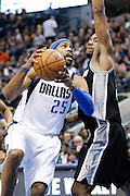 Dallas Mavericks shooting guard Vince Carter (25) tries to lay the ball up against San Antonio Spurs small forward Kawhi Leonard (2) in the first half at American Airlines Center in Dallas, Texas, on January 25, 2013.  (Stan Olszewski/The Dallas Morning News)