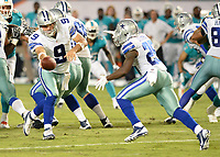 August 23rd, 2014, Dallas Cowboys quarterback Tony Romo (9) during a game between the Miami Dolphins and the Dallas Cowboys at Sun Life Stadium in Miami Garden, FL NFL American Football Herren USA AUG 23 Preseason - Cowboys at Dolphins PUBLICATIONxINxGERxSUIxAUTxHUNxRUSxSWExNORxONLY Icon140823009<br /> <br /> August 23rd 2014 Dallas Cowboys Quarterback Tony Romo 9 during A Game between The Miami Dolphins and The Dallas Cowboys AT Sun Life Stage in Miami Garden Fl NFL American Football men USA Aug 23 Preseason Cowboys AT Dolphins PUBLICATIONxINxGERxSUIxAUTxHUNxRUSxSWExNORxONLY